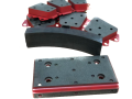BRAKE PADS AND WEAR PLATE FOR TRAIN